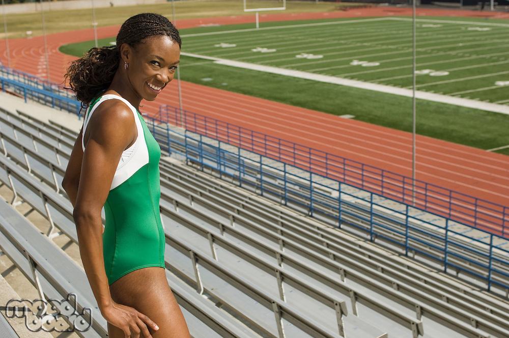Female track athlete looking over stadium