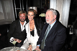 Left to right, STEFANO PILATI, EVA HERZIGOVA and COLIN MCDOWELL at a party for Yves Saint Laurent's Creative Director Stefano Pilati given by Colin McDowell held at The Connaught Bar, The Connaught, Mount Street, London on 29th October 2008.