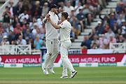 Ben Stokes of England and Chris Woakes of England celebrate the wicket of KL Rahul of India during the 3rd International Test Match 2018 match between England and India at Trent Bridge, West Bridgford, United Kingdon on 18 August 2018.