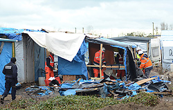 © Licensed to London News Pictures . 04/03/16 . Workmen and French authorities continue to clear large parts of the migrant camp in Calais, known as the Jungle. Photo credit : Ian Homer/LNP