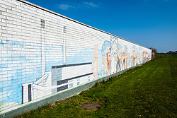 View of mural showing industrial history at site of the former Cockenzie power station in East Lothian, Scotland.
