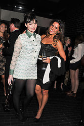 Left to right, GIZZI ERSKINE and AMANDA BYRAM at the InStyle Best of British Talent Event in association with Lancôme and Charles Worthington held at The Rooftop Restaurant, Shoreditch House, Ebor Street, E1 on 26th January 2012.