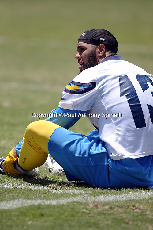 San Diego Chargers wide receiver Keenan Allen (13) talks to a teammate while stretching during the San Diego Chargers Spring 2015 NFL minicamp practice on Wednesday, June 17, 2015 in San Diego. (©Paul Anthony Spinelli)