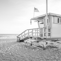 Santa Monica California Lifeguard Tower 16 along the Pacific Ocean at Santa Monica California State Beach. Photo is black and white and high resolution. Copyright ⓒ 2017 Paul Velgos with All Rights Reserved.