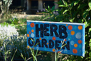 Berkeley, California, June, 2008-A sign hand painted by children labeling an herb garden at the Edible Schoolyard. The organic garden was founded by Alice Waters of Chez Panisse to involve students in all aspects of farming.
