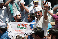 Varanasi, Uttar Pradesh, India. 23rd April, 2014. AAP Party Chief Arvind Kejriwal makes his way through a throng of supporters in Varanasi to file his nomination papers for the Indian Lok Sabh elections. In 2012, he launched theAam Aadmi Party, and defeated Chief MinisterSheila Dikshitin the2013 Delhi Legislative Assembly election. Tomorrow is the turn of Narendra Modi to file his papers also in the Uttar Pradesh city.