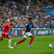 PARIS, FRANCE - September 10:   Kingsley Coman #11 of France defended by Moisés San Nicolás #15 of Andorra during the France V Andorra, UEFA European Championship 2020 Qualifying match at Stade de France on September 10th 2019 in Paris, France (Photo by Tim Clayton/Corbis via Getty Images)