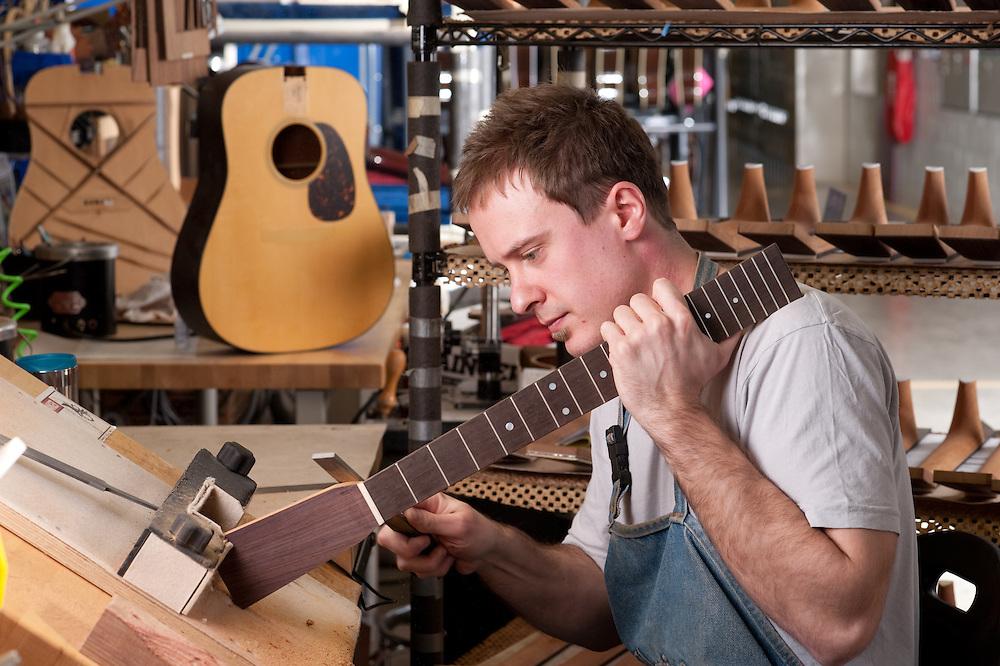 Craftsman in handmade guitars factory