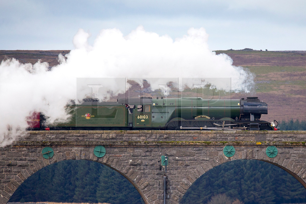 © Licensed to London News Pictures. 31/03/2017. Ribblehead UK. The Flying Scotsman locomotive crosses the Ribblehead Viaduct in the Yorkshire Dales this morning marking the re-opening of the Settle to Carlisle rail line. Journeys on the line were halted more than a year ago after heavy storms in late 2015 caused a landslide in Cumbria & £23m of repairs were needed.Photo credit: Andrew McCaren/LNP