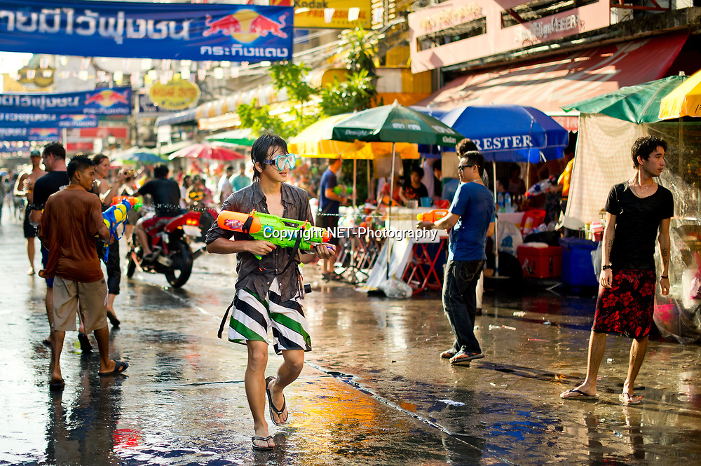 A man pump his water gun during the Songkran festival at Khao San road, a popular tourist area in Bangkok. Songkran is the traditional Thai New Year festival. The most obvious celebration of Songkran is the throwing of water.