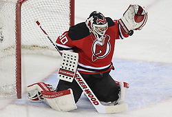 April 24, 2012; Newark, NJ, USA; New Jersey Devils goalie Martin Brodeur (30) makes a glove save during the first period of game six of the 2012 Eastern Conference quarterfinals at the Prudential Center.