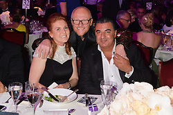 Left to right, SARAH, DUCHESS OF YORK, JOHN CAUDWELL and KAM BABAEE at the Caudwell Children's annual Butterfly Ball held at The Grosvenor House Hotel, Park Lane, London on 15th May 2014.