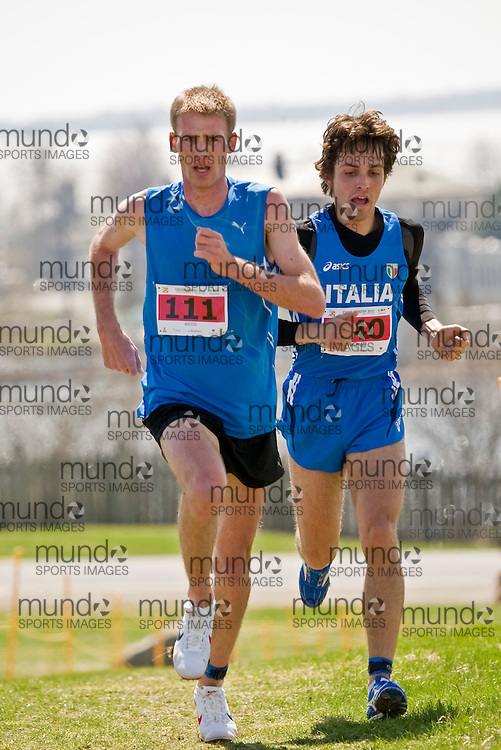 (Kingston, Canada---11 April 2010) Mario Weiss (#111) of Austria (AUT) and Alessandro Ruffoni (#140) of Italy (ITA) runs in the \men's 10km race\ at the 17th World University Cross Country Championships (FISU) held on the Fort Henry Hill course in Kingston, Ontario, Canada. This photograph is Copyright Sean Burges / Mundo Sport Images, 2010. For information, go to www.mundosportimages.com or contact info@mundosportimages.com.