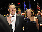Gov. Dan Malloy and his wife Cathy arrive at the Governor's Ball at Connecticut Convention Center in Hartford, Conn., Wednesday, Jan. 5, 2011.  (AP Photo/Jessica Hill)