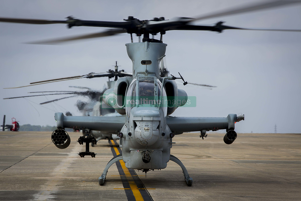 April 26, 2017 - Okinawa, Japan - A U.S. Marine Corps AH-1W Super Cobra attack helicopters begin pre-flight checks, prior to a Mission Rehearsal Exercise at Marine Corps Air Station Futenma in Okinawa, Japan. U.S. Forces across the Asian region have increased combat exercises as tensions continue to rise between the U.S. and North Korea. (Credit Image: © Lcpl. Juan C. Bustos/Planet Pix via ZUMA Wire)