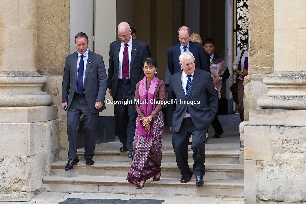 Aung San Suu Kyi, Chairman of the Burmese National League for Democracy and member of the Burmese parliament, is welcomed to the University by the Chancellor, Lord Patten of Barnes; the Vice-Chancellor, Professor Andrew Hamilton (red and blue tie); and the Principal of St Hugh&rsquo;s College, Mr Andrew Dilnot.  Tuesday 19  June  2012.  Oxford, UK.<br /> Photo by: Mark Chappell/i-Images