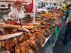 Cooked food stall at traditional market at Bastille in Paris France