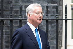 © Licensed to London News Pictures. 17/10/2017. London, UK. Defence Secretary Sir Michael Fallon leaving No 10 Downing Street after attending a Cabinet meeting this morning. Photo credit : Tom Nicholson/LNP