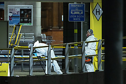 © Licensed to London News Pictures . 01/01/2019 . Manchester, UK. Crime Scene Investigators work at the scene on Metrolink platform B at Victoria Station . Anti terrorism police have closed off Victoria Station in Manchester and launched an investigation after several people were stabbed , including a British Transport Police officer , in a knife attack last night (Monday 31st December 2018). A man is under arrest for attempted murder . Photo credit: Joel Goodman/LNP