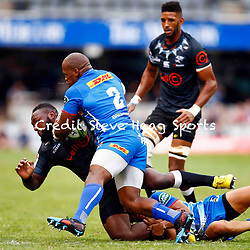 Bongi Mbonambi of the DHL Stormers tackling Tendai Beast Mtawarira of the Cell C Sharks during the Super Rugby match between Cell C Sharks and DHL Stormers at Jonsson Kings Park on March 02, 2019 in Durban, South Africa. (Photo by Steve Haag)