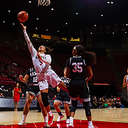 09 November 2018: San Diego State Aztecs guard Te'a Adams (5) lays the ball up for two points while being surrounded by Hawaii defenders in the fourth quarter. The Aztecs opened up it's regular season schedule with a 58-57 win over Hawaii Friday at Viejas Arena.