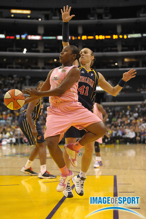 Aug 9, 2010; Los Angeles, CA, USA; Los Angeles Sparks guard Andrea Riley (10) is defended by Indiana Fever guard Tully Bevilaqua (41) at the Staples Center. Photo by Image of Sport