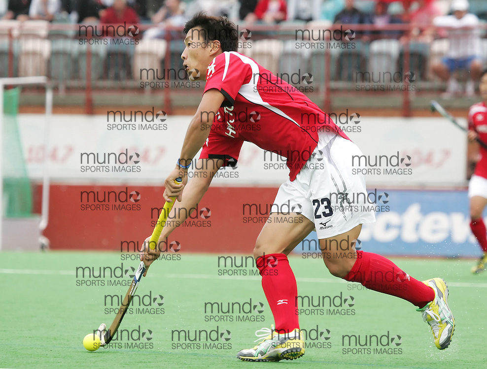 (Canberra, Australia---01 April 2012) Hiroki Sakamoto of Japan playing in the third of a three game field hockey test match series between Australia and Japan men's field hockey teams. Australia won the game 7-1 and the series 3-0. 2012 Copyright Photograph Sean Burges / Mundo Sport Images.