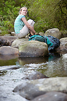 Young Woman Resting by Creek