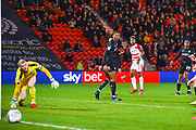 Mallik Wilks of Doncaster Rovers (7) shoots wide as Adam Davies of Barnsley (1) looks on during the EFL Sky Bet League 1 match between Doncaster Rovers and Barnsley at the Keepmoat Stadium, Doncaster, England on 15 March 2019.