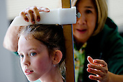 Fiona O'Keefe, 8, of Carmichael is measured by volunteer Janice Steenhock before auditioning for the Sacramento Ballet's Nutcracker production on Sunday, September 10, 2006. The children parts are segmented by height. (Photo by Max Whittaker)