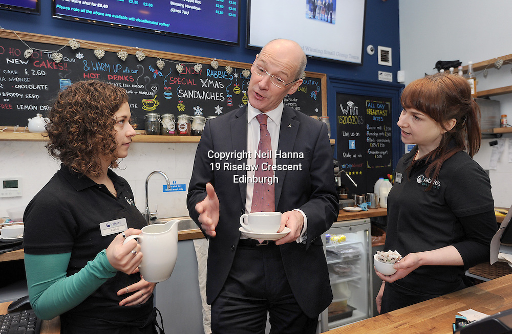 Edinburgh 08/1/2015<br /> <br /> Deputy First Minister John Swinney  visited Rabbie&rsquo;s Tours in Edinburgh today to hear how their decision to become a Living Wage Accredited employer has strengthened their business. Mr Swinney  meet with senior management and staff including Rabbie's Cafe staff Rachel Robson (curly hair) and Jude Sevestre who shared their coffee making techniques to Mr Swinney<br /> <br />  Later today Mr Swinney will address parliament in the Boosting the Economy debate where he will set out the actions of the Scottish Government in boosting economic growth and tackling inequality.<br /> <br /> Rabbie&rsquo;s believe that the Living Wage is good for employees and their families, good for Rabbie's and good for the wider economy. The company is already benefitting by seeing greater staff engagement.<br /> <br /> <br /> <br />  Neil Hanna Photography<br /> www.neilhannaphotography.co.uk<br /> 07702 246823
