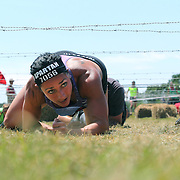 Jennifer DasNeves in action at the barbed wire crawl obstacle during the Reebok Spartan Race. Mohegan Sun, Uncasville, Connecticut, USA. 28th June 2014. Photo Tim Clayton