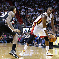 17 January 2012: San Antonio Spurs forward Malcom Thomas (23) defends on Miami Heat power forward Chris Bosh (1) during the Miami Heat 120-98 victory over the San Antonio Spurs at the AmericanAirlines Arena, Miami, Florida, USA.