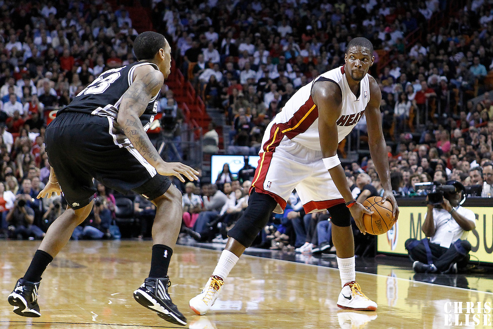 17 January 2012: San Antonio Spurs forward Malcom Thomas (23) defends on Miami Heat power forward Chris Bosh (1) during the Miami Heat 120-98 victory over the San Antonio Spurs at the AmericanAirlines Arena, Miami, Florida, USA.