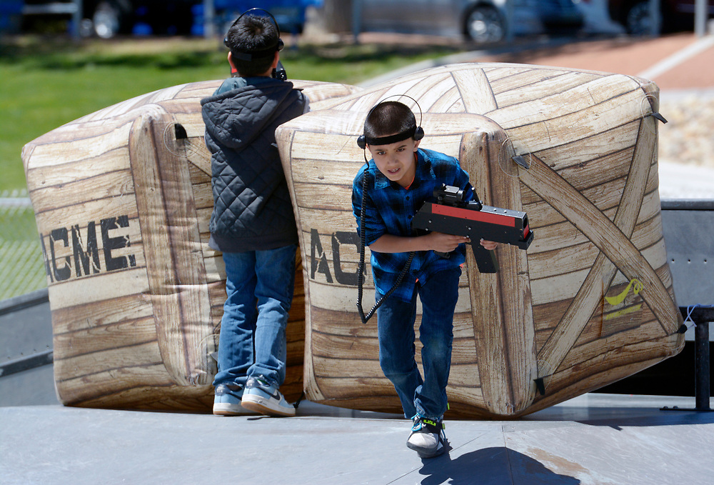gbs043017h/RIO-WEST -- Ezekiel Chavez, 9, right,  plays laser tag in the skate park of Paradise Park during the Day in Paradise celebration on Sunday, April 30, 2017. Kids could play free with equipment from Battlefield New Mexico.(Greg Sorber/Albuquerque Journal)