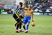 Mansfield Town midfielder Jorge Grant and Notts County forward Lewis Alessandra Virgil Gomis (10) to the ball during the EFL Sky Bet League 2 match between Notts County and Mansfield Town at Meadow Lane, Nottingham, England on 16 February 2019.
