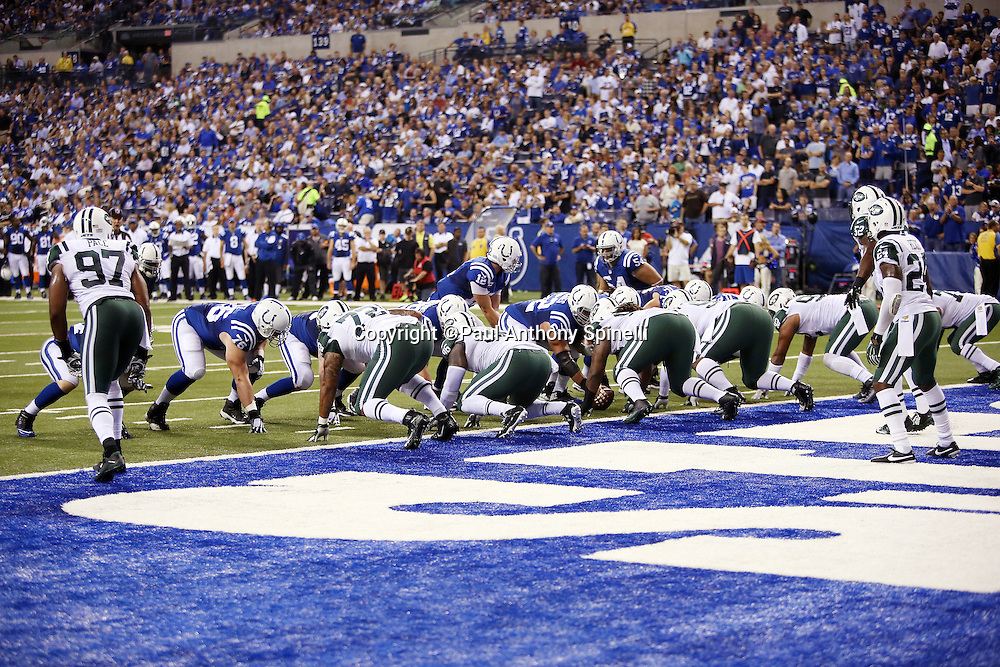 The New York Jets defense mounts a goal line stand against the Indianapolis Colts offense during the 2015 NFL week 2 regular season football game against the Indianapolis Colts on Monday, Sept. 21, 2015 in Indianapolis. The Jets won the game 20-7. (©Paul Anthony Spinelli)