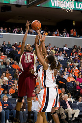 Florida St. forward/center Jacinta Monroe (50) shoots over Virginia forward Lyndra Littles (1).  The Virginia Cavaliers women's basketball team defeated the Florida State Seminoles 77-58 at the John Paul Jones Arena in Charlottesville, VA on February 10, 2008.