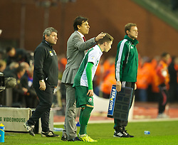 BRUSSELS, BELGIUM - Tuesday, October 15, 2013: Wales' manager Chris Coleman prepares to bring on his country's youngest ever player, 16-year-old Harry Wilson, against Belgium during the 2014 FIFA World Cup Brazil Qualifying Group A match at the Koning Boudewijnstadion. (Pic by David Rawcliffe/Propaganda)