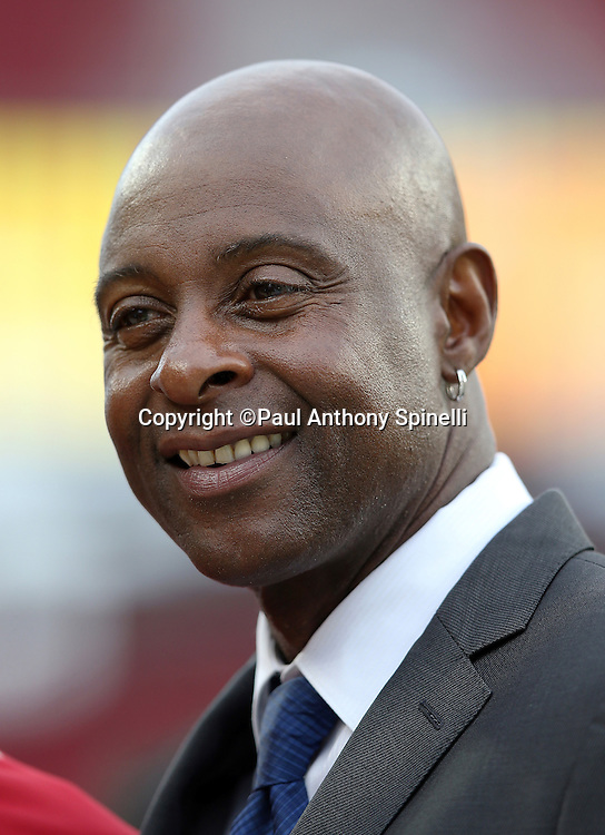 Former San Francisco 49ers wide receiver Jerry Rice smiles as he chats on the sideline before a special ceremony honoring former defensive end Charles Haley (not pictured) before the San Francisco 49ers 2015 NFL week 1 regular season football game against the Minnesota Vikings on Monday, Sept. 14, 2015 in Santa Clara, Calif. The 49ers won the game 20-3. (©Paul Anthony Spinelli)