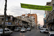 A Hamas posted banner drives home the party's security message across a Gaza city street August 06, 2007 in Gaza City, Gaza. After  taking control in a violent coup in June, Hamas had a hand politically in the release of kidnapped BBC reporter Alan Johnston a short time later. Since then, the group has made a point of trying to convince the international press that it is now safe to return back to Gaza.