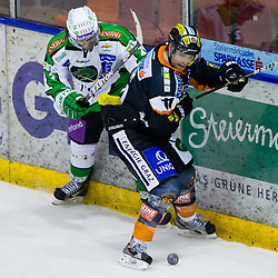 Brad Cole (HDD Tilia Olimpja, #2) vs Brett Lysak (Moser Medical Graz 99ers, #11) during of ice-hockey match between Moser Medical Graz 99ers and HDD Tilia Olimpija in 11th Round of EBEL league, on October 14, 2011 at Eisstadion Graz-Liebenau, Graz, Austria. (Photo By Matic Klansek Velej / Sportida)