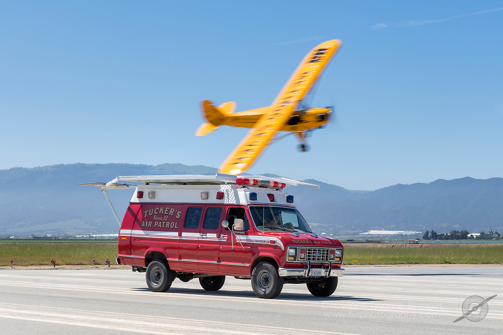 Erik Tucker lands his Piper J3 Cub atop a moving van for the 2018 airshow season at the Salinas Municipal Airport