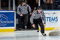 KELOWNA, CANADA - NOVEMBER 17: Linesmen Tim Plamondon and Cody Wanner enter the ice at the start of warm up as the Lethbridge Hurricanes visit the Kelowna Rockets on November 17, 2017 at Prospera Place in Kelowna, British Columbia, Canada.  (Photo by Marissa Baecker/Shoot the Breeze)  *** Local Caption ***