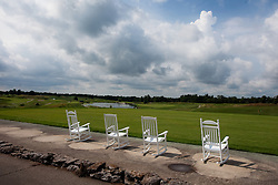 Rocking chairs behind practice driving range. Kearney Hill Golf Links located in Lexington Kentucky Friday, July 08, 2011.