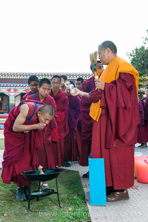 H.E. the ponlop Rinpoche is offering the blessed water to all the villager, monks, children and the nuns in a religious ceremony at the Tibetan YungDrung Bon Monastery at Dolanji.