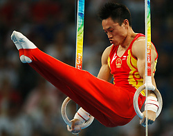 China's Yang Wei competes on the rings for artistic gymnastics men's individual all-around  finals during the Olympic games in Beijing, China, 14 August 2008. China's Yang Wei competes on the parallel bars for artistic gymnastics men's individual all-around  finals during the Olympic games in Beijing, China, 14 August 2008. Yang won the gold medal for China with Japan and France taking silver and bronze respectively.