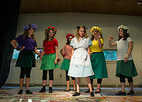 Violet (Rebecca Wittenberg), Rose (Jenny Laurendeau), Petunia (Rose Hynes), Lily (Olivia Mills) and Daisy (Kelsey Trudeau) greet Alice (Ella Denney) during dress rehearsal for SKYT's Alice in Wonderland Jr at the Gilford Methodist Church on Monday evening.  (Karen Bobotas/for the Laconia Daily Sun)