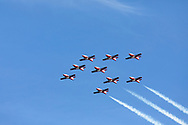 Canadian Forces Snowbirds in the Big Arrow formation with smoke.  The Snowbirds are also known as the 431 Air Demonstration Squadron and fly the Canadair CT-114 Tutor jet. Photographed during the Canada 150 celebrations in White Rock, British Columbia, Canada.