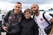 Walsall midfielder Kieron Morris (11) and Walsall midfielder Adam Chambers (7) pose with a fan during the EFL Sky Bet League 1 match between Walsall and Oldham Athletic at the Banks's Stadium, Walsall, England on 12 August 2017. Photo by Alan Franklin.